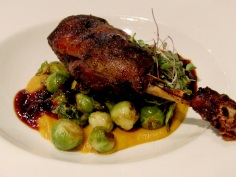 Confit moulard duck leg with ginger-autumn squash purée, braised red cabbage, gala apples