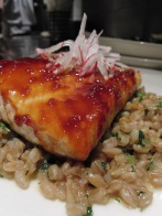 Barbecued Atlantic salmon fillet on English peas, radishes and farro