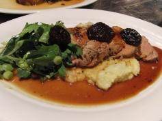 Grilled maple glazed pork tenderloin with mushroom polenta, green onions and prunes