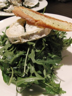 Baked aged goat cheese: Baby arugula salad, toasted almonds, red onion and balsamic vinaigrette