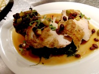 Roasted free-range chicken with foie gras bread pudding, braised greens, apples, black currants and pistachio dust