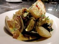 New England bouillabaisse Local cod, Wellfleet littleneck clams, Blue Hill Bay mussels, Blue prawns, fennel, potato, and saffron rouille