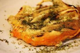 Provoleta, grilled provolone cheese with basil