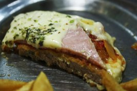 Milanesa with ham and cheese. The Argentine wienerschnitzel