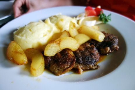 Seared foie gras over mashed potato with pears