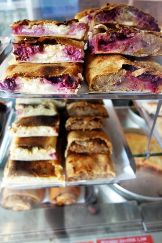 Zavitek (strudel type pastry) with sour cherries and sweet cream.