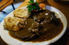 Braised goat with Kruhovi smoki dumplings