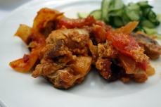 Lecsó stew of meat with peppers and tomato