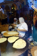 Gözleme, paper-thin, yeast-free yufka dough stretched into a crepe and cooked on an iron burner called a sac, filled with cheese and spinach