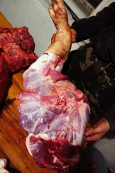 A leg is removed and stored separately. This will be sliced into hams to cure and cook.