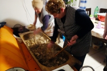 The ladies toil for close to 20 minutes over the trough, mixing the herbs, rice and innards into a homogenous filling.