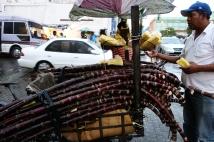 Buying some sugar cane