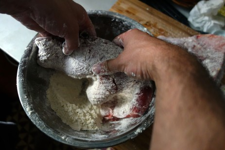 Salting and flour dusting two large filets.