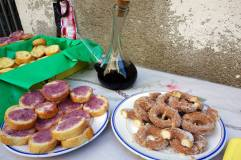 Porron, bread soaked in red wine and sprinkled with sugar