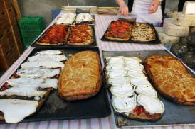 Lots of different cocas (Catalan flat breads)