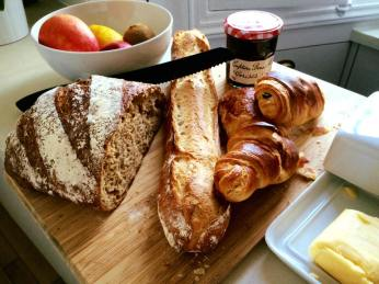 Amazing breakfast of bread, pastries, butter and jam