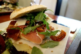 Sesame seed bagel with Parma ham, sundried tomato, cream cheese and pesto at APDM Brussels