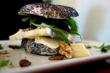 Poppy seed bagel with Brie, honey, walnuts, arugula at APDM Brussels
