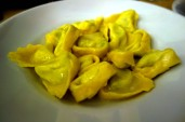 Tortellini stuffed with ricotta at Osteria Broccaindosso in Bologna