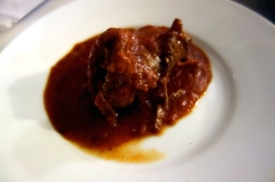 Beef wrapped around ham with tomato sauce
